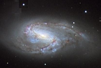 Aslan takımyıldızındaki M66 sipiral galaksisi.