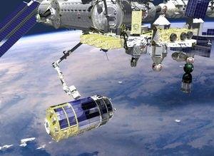 Uluslar Arası Uzay İstasyonu'nun robotik kolu Canadarm 2, HTV'yi yakalarken herhalde böyle görünürdü.
